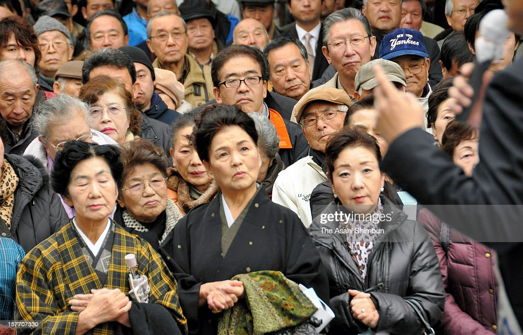 People listen to a street speech on December 4, 2012 in Ichikawa, Chiba, Japan. The general election capmaign officially began for December 16, with the election issues such as nuclear power energy, economy growth and Trans Pacific Partnership negotiations.