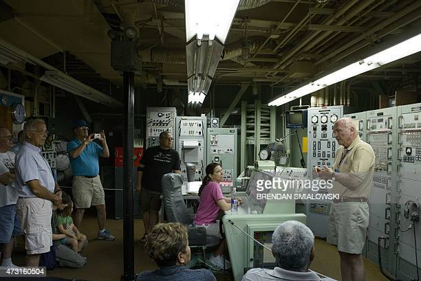 People listen to a tour guide inside a Titan II silo's control center at the Titan Missile Museum on May 12 2015 in Green Valley Arizona The museum...