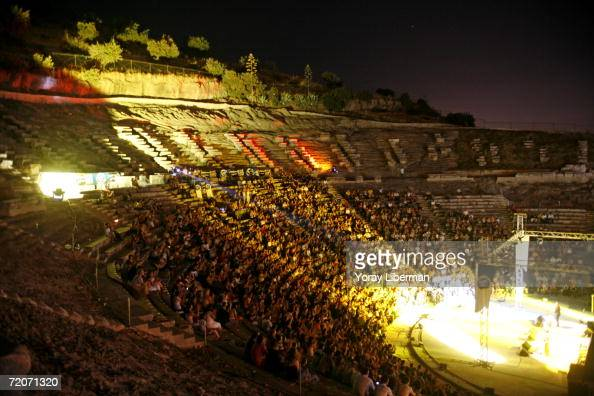 People listen to a Turkish music concert in the 4th century BC Amphitheater of Bodrum August 5 2006 in Bodrum Turkey Bodum and its peninsula are at...