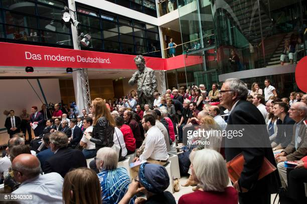 People listen to Chancellor Candidate and Chairman of the Social Democratic Party Martin Schulz speaking during the event 'Zukunft Gerechtigkeit...