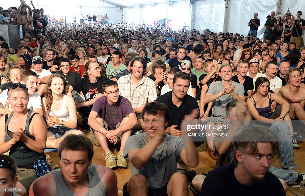 People listen to German President and his Polish counterpart during a music festival 'Woodstock fastival Poland' in Kostrzyn nad Odra on August 2, 2012.