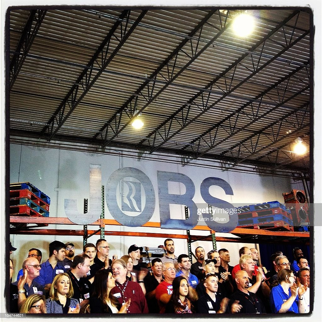 People listen to Republican presidential candidate, former Massachusetts Gov. <a gi-track='captionPersonalityLinkClicked' href=/galleries/search?phrase=Mitt+Romney&family=editorial&specificpeople=207106 ng-click='$event.stopPropagation()'>Mitt Romney</a> speak during a campaign rally on October 25, 2012 in Cincinnati, Ohio. <a gi-track='captionPersonalityLinkClicked' href=/galleries/search?phrase=Mitt+Romney&family=editorial&specificpeople=207106 ng-click='$event.stopPropagation()'>Mitt Romney</a> is campaigning in Ohio with less than two weeks to go before the election.