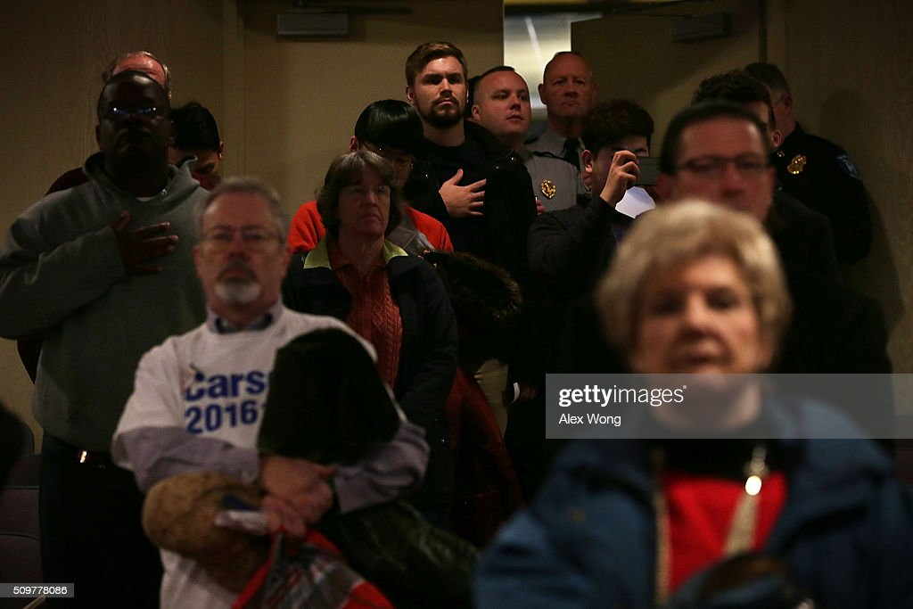 People listen to the nationa anthem during the South Carolina Faith and Family Presidential Forum February 12, 2016 in Greenville, South Carolina. Four Republican candidates joined the forum as they continued to campaign in the Palmetto State.