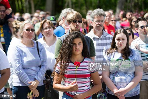 People listen to tributes during a memorial service for victims of the 2003 fire at the Station Nightclub in West Warwick RI on May 21 2017 14 years...
