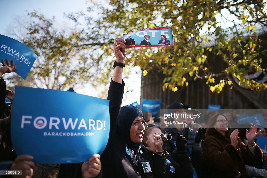 People listen to U.S. Vice President Joe Biden speak during a campaign rally at the Heritage Farm Museum, on November 5, 2012 in Sterling, Virginia. Tomorrow voters nationwide will head to the polls to vote in the presidential and congressional elections.