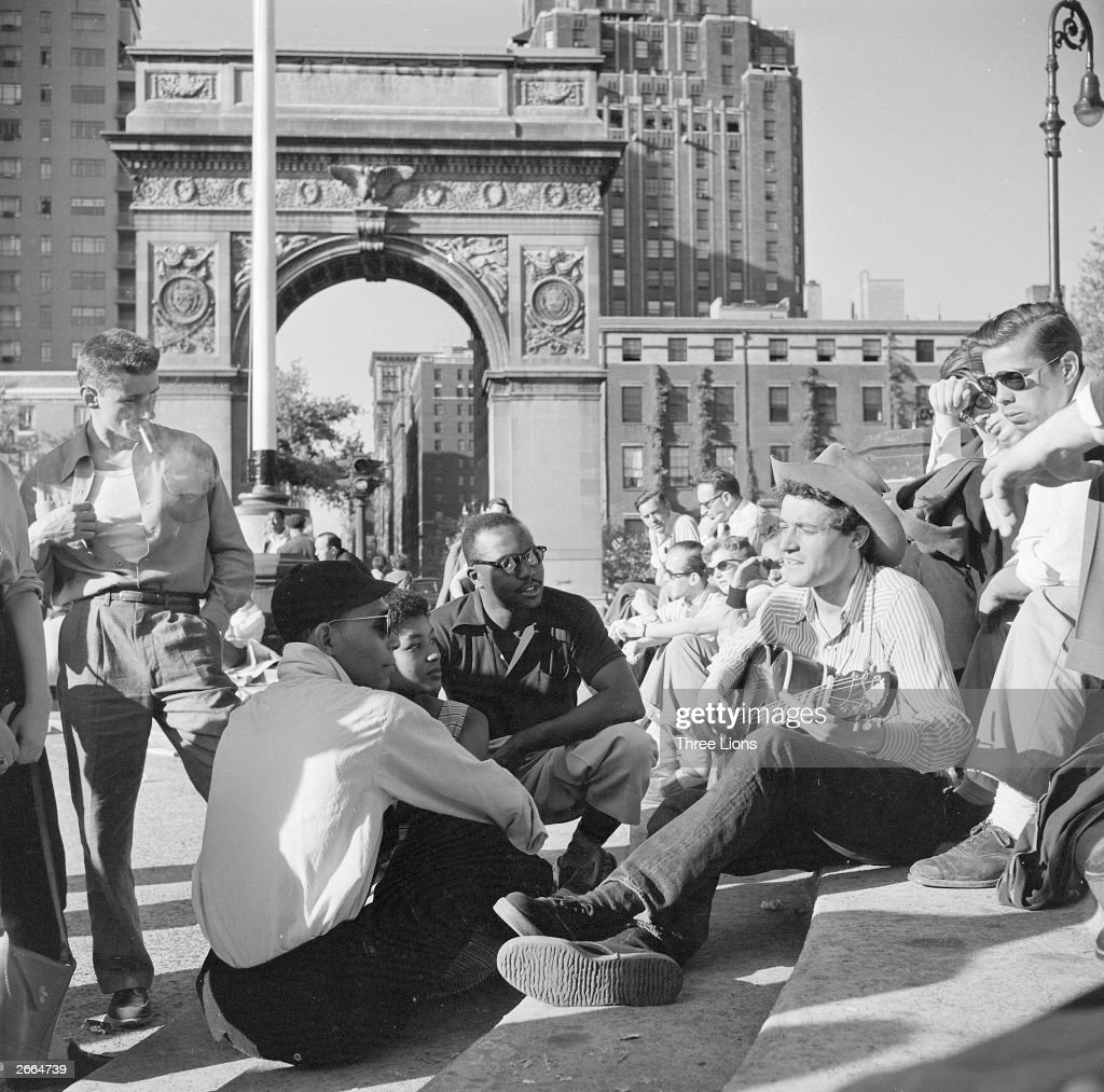 People listening to folk singer Ramblin' Jack Elliott on a Sunday afternoon in Washington Square Greenwich Village New York