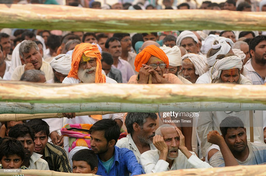 People listening to the speech by chief Minister of Bihar, Nitish Kumar who addressed a rally in which he lambasted on the central and state government demanding liquor ban at Jewar on June 29, 2016 in Greater Noida, India. Kumar targeted Prime Minister Narendra Modi for showing off Yoga and allowing sale of liquor. At anti-liquor rally, Kumar sought support of the residents of Uttar Pradesh to ban liquor.