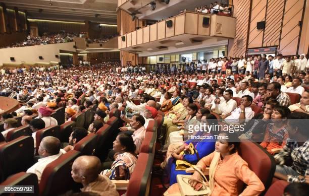 People listening to the Union External Affairs Minister Sushma Swaraj during a programme 'Sabka Sath Sabka Vikas' to celebrate their achievements in...