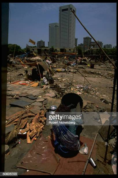 People living in tents in Back Bay reclamation area slum w highpriced real estate Cuffe Parade area highrises looming beyond