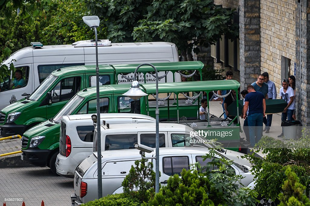 People load the coffin of a victim of a bombing into a hearse at the forensic building close to Istanbul's airport on June 29, 2016, a day after a triple suicide bombing and gun attack at the international airport. The bombing left 41 people dead and 239 wounded, the city governor said in a statement. The attackers began spraying bullets at the international terminal entrance before blowing themselves up at around 10:00 pm (1900 GMT) on June 28, Turkish authorities said. / AFP / OZAN