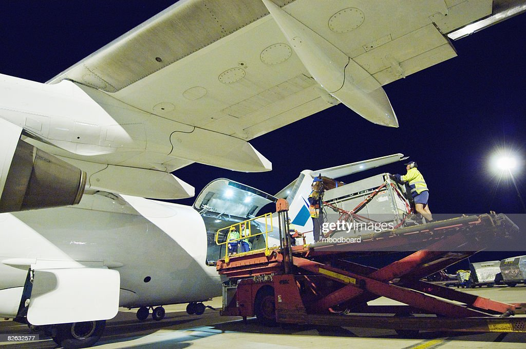 People loading aeroplane at airport