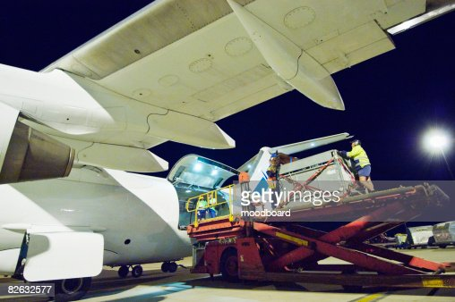 People loading aeroplane at airport