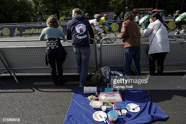 People look as bicycle enthusiasts ride a bike part at the 8th Garmin Velothon on May 31 2015 in Berlin Germany Ten thousand bike enthusiasts drove...