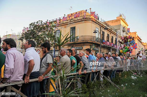 People look at a 25metre tall wood and papiermache statues called 'giglio' during the annual Festa dei Gigli di Barra on September 25 2016 in Naples...