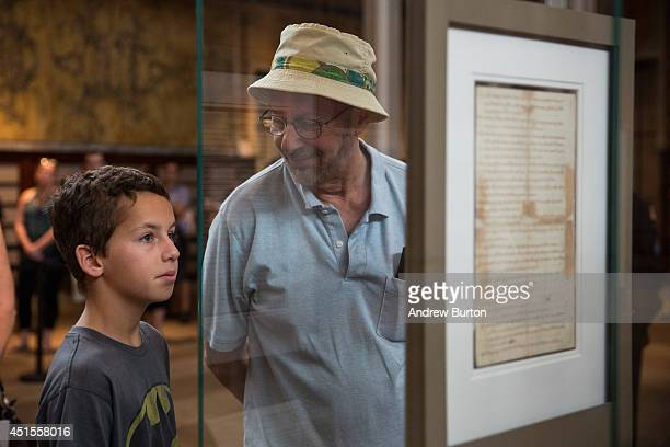 People look at a copy of The Declaration Of Independence on display at the New York Public Library on July 1 2014 in New York City The copy which was...