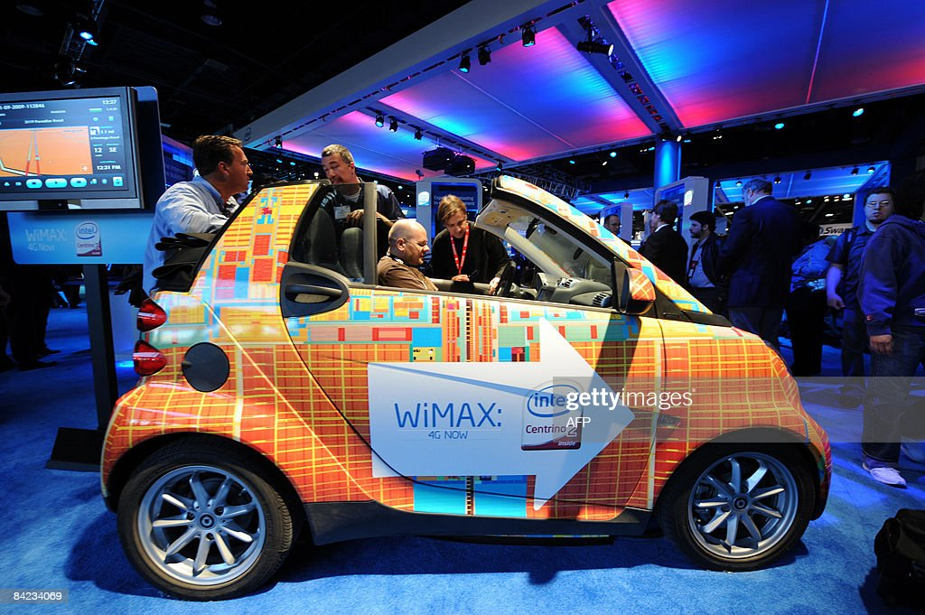 People look at a customized Smart Car with WiMAX and an Intel Centrino 2 processor, at the Intel display at the Consumer Electronics Show in Las Vegas, Nevada on January 9, 2009.