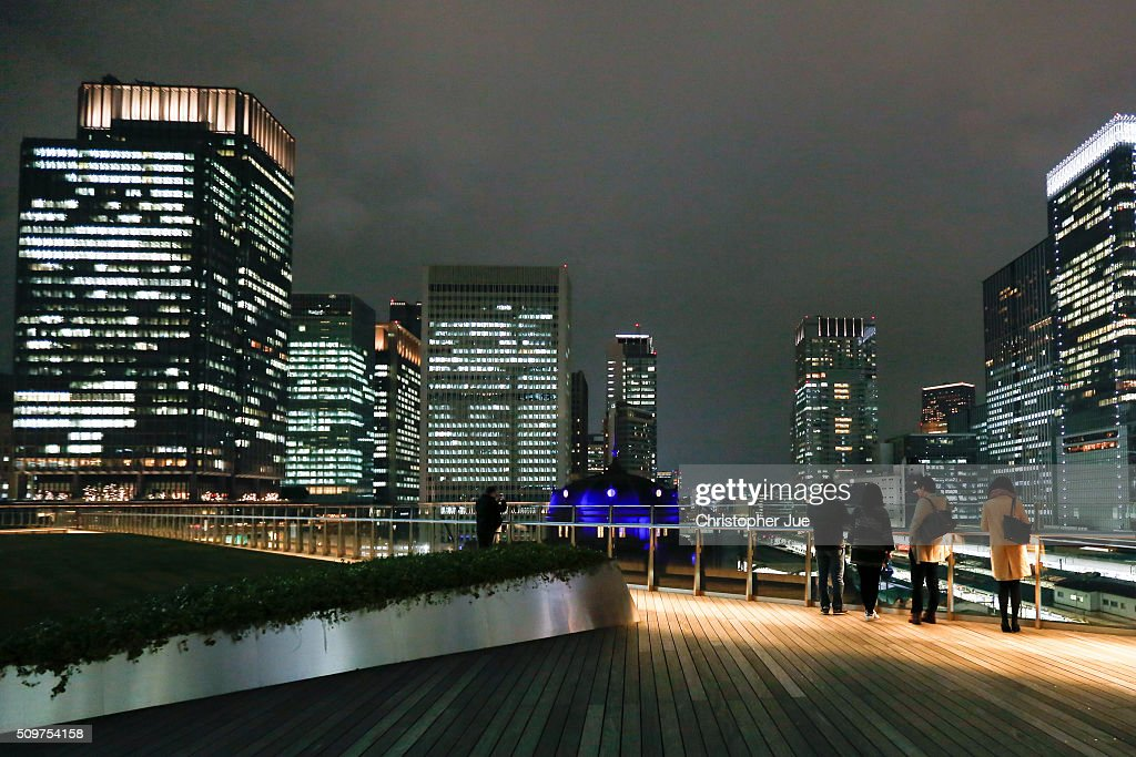 People look at a general view of downtown Tokyo on February 12, 2016 in Tokyo, Japan. The Nikkei Stock Average finished 11% down for the week, its biggest weekly drop since October 2008, and the index for the day ended 4.8% down, the lowest since October 2014.
