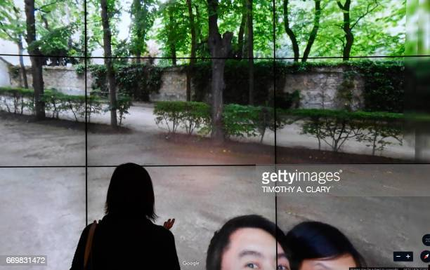 People look at a Google Earth map of the Rodin Museum in Paris France on a screen as Google Earth unveils the revamped version of the application...