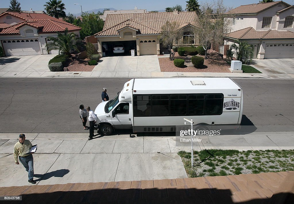 People look at a house during a bus tour of bankowned homes April 6 2008 in the Las Vegas suburb of Henderson Nevada The Prudential Americana Group...