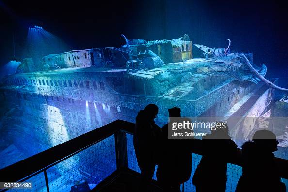 People look at a largescale 360 degree panorama presentation of the Titanic shipwreck by artist Yadegar Asisi during a press preview on January 27...
