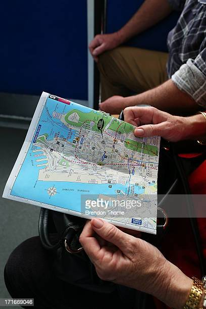 People look at a map of the Sydney monorail system from inside a Sydney monorail carriage on June 26 2013 in Sydney Australia The Sydney monorail...