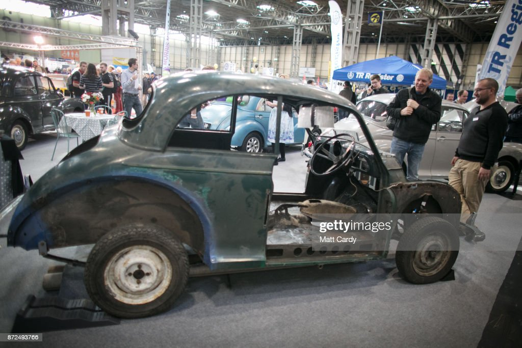 People look at a Morris Minor that has been stripped for restoration on the first day of the Lancaster Classic Motor Show at the NEC Birmingham on November 10, 2017 in Birmingham, England. According to a recent survey by the Federation of British Historic Vehicles Clubs, the historic vehicle industry currently generates revenues in excess of £5.5 billion per year for the UK economy, and while current government policy is to promote self-driving and low carbon cars, according to Transport Minister Chris Grayling his party is also committed to supporting owners of classic cars, and those that want to continue to use them on the road in the future.