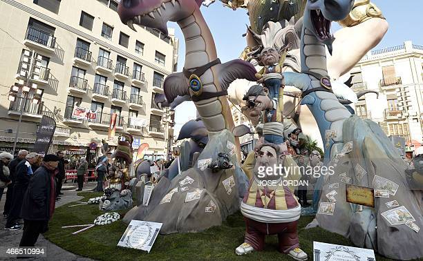 People look at a 'ninot' representing President of proindependence Esquerra Republicana political party Oriol Junquera regional president of...