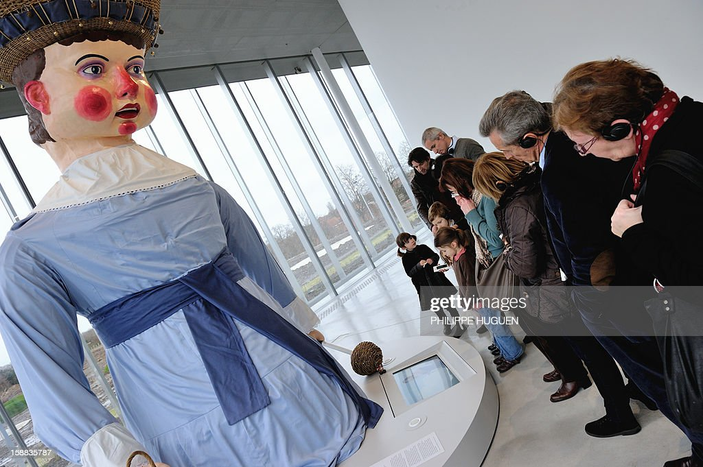 People look at a Northern France giant 'binbin' at the Louvre-Lens museum on December 31, 2012 in Lens, northern France. Three weeks after its inauguration, the museum welcomed its 100.000th visitor on December 28, 2012.