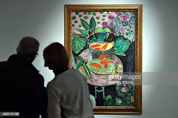 People look at a painting by French artist Henri Matisse during a press preview of the exhibition 'Matisse Arabesque' on March 4 2015 at the Scuderie...