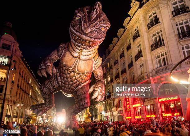 people look at a parade float picturing 'Godzilla' during the parade of the Lille 3000 event on September 26 2015 in Lille This year's event with the...