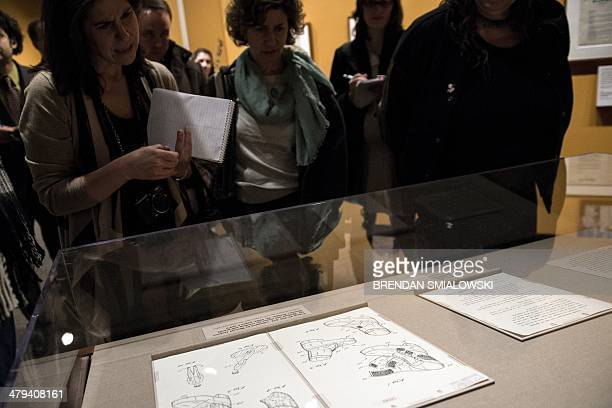People look at a patent application for special dance shoes by Michael Jackson during a press preview at the National Archives on March 18 2014 in...
