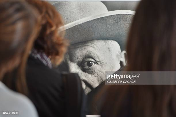 People look at a picture by photographer Irving Penn showing a portrait of painter Pablo Picasso as part of the exhibition 'Irving Penn Resonance' at...