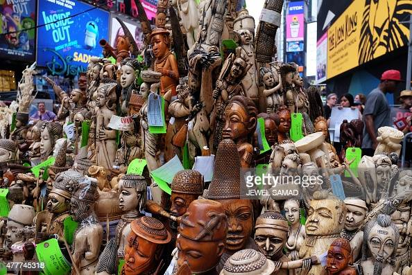 People look at a pile of artworks made out of ivory during a ceremony at the Times Square in New York on June 19 2015 The US Fish and Wildlife...