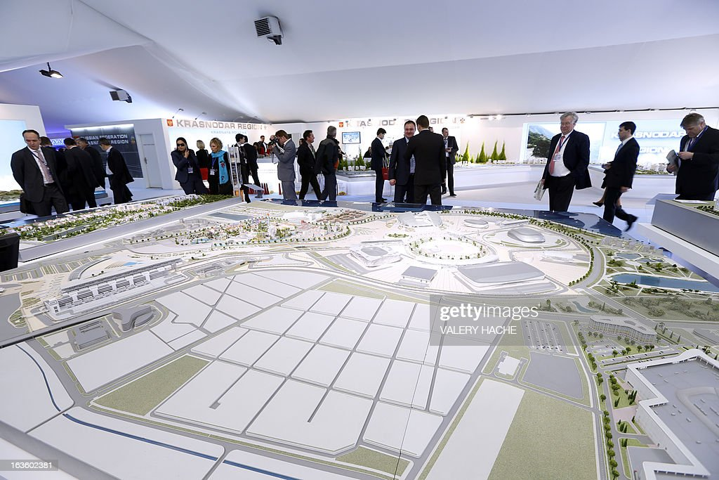 People look at a scale model of a project of a Formula One race track on the Russian Federation stand on March 13, 2013 at the Palais des Festivals in Cannes, southeastern France, during the MIPIM, an international real estate show for professionals. The event takes place until March 15.