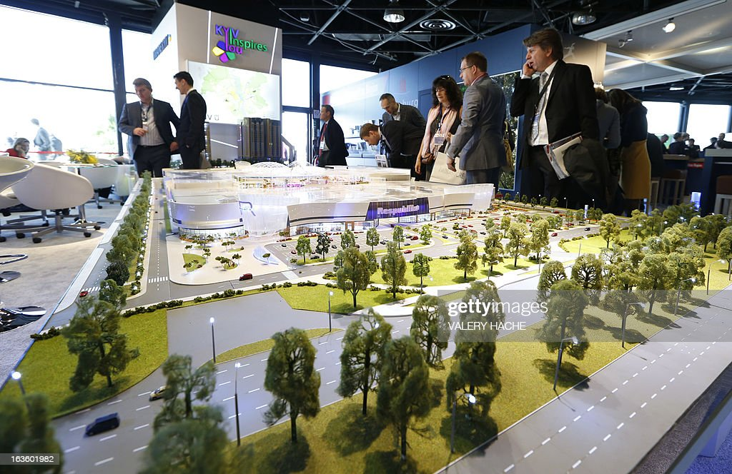 People look at a scale model of the city of Kyiv on March 13, 2013 at the Palais des Festivals in Cannes, southeastern France, during the MIPIM, an international real estate show for professionals. The event takes place until March 15.