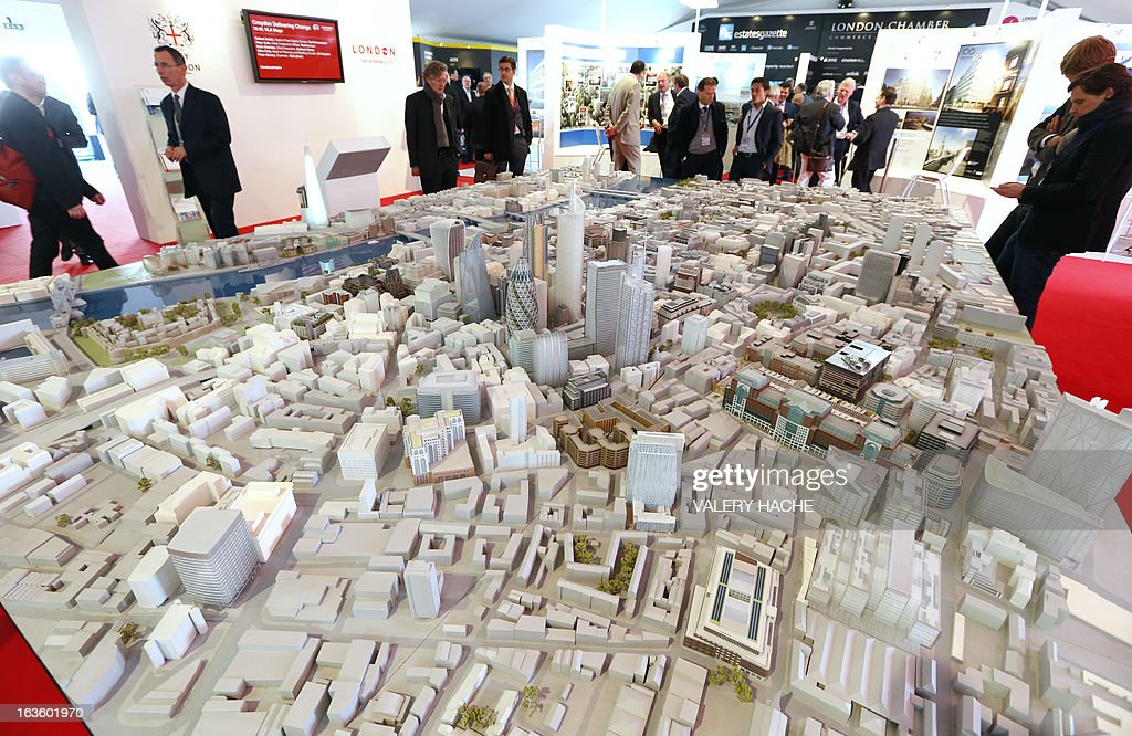 People look at a scale model of the city of London on March 13, 2013 at the Palais des Festivals in Cannes, southeastern France, during the MIPIM, an international real estate show for professionals. The event takes place until March 15.