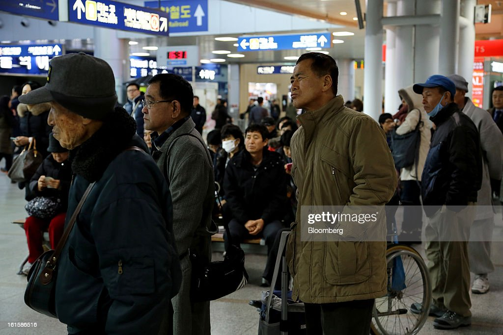 People look at a television screen showing a news broadcast on North Korea's nuclear test at Seoul Station in Seoul, South Korea, on Tuesday, Feb. 12, 2013. North Korea conducted its third underground nuclear test today, underscoring a disregard for an international community that has already isolated the totalitarian state from the global economy. Photographer: SeongJoon Cho/Bloomberg via Getty Images