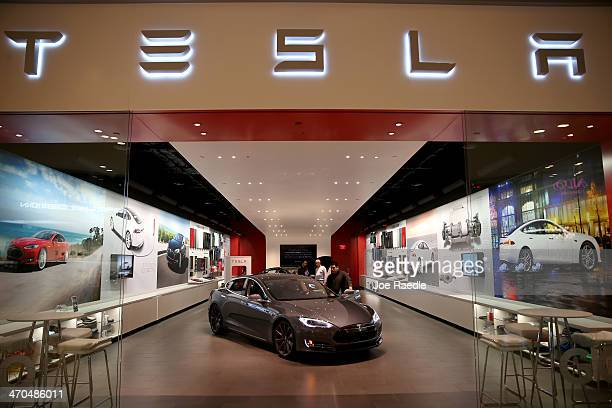 People look at a Tesla Motors vehicle on the showroom floor at the Dadeland Mall on February 19 2014 in Miami Florida Tesla said today it earned $46...