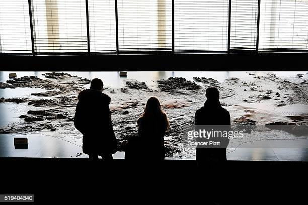 People look at a topographical map of Iceland in a museum on April 6 2016 in Reykjavik Iceland Icelandic Prime Minister Sigmundur David Gunnlaugsson...
