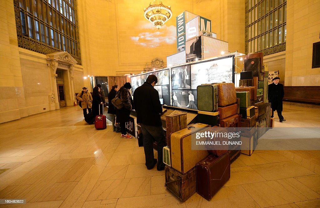 People look at an exhbition part of Grand Central Terminal centennial celebrations in New York, February 1 , 2013 . Grand Central Terminal, the doyenne of US train stations, is celebrating its100th birthday on February 2, 2013. Opened on February 2, 1913, when trains were a luxurious means of traveling across America, the New York landmark with its Beaux-Arts facade is still one of the US largest transportation hubs and is also theNew York's second-most-popular tourist attraction, after Times Square. AFP PHOTO/Emmanuel Dunand