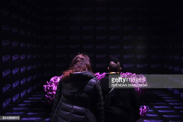 People look at an exhibit during a preview of the Yayoi Kusama's Infinity Mirrors exhibit at the Hirshhorn Museum February 21 2017 in Washington DC...