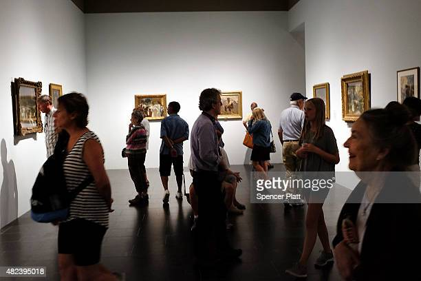 People look at an exhibition at the Metropolitan Museum of Art on July 30 2015 in New York City The Met recently announced that it drew 63 million...