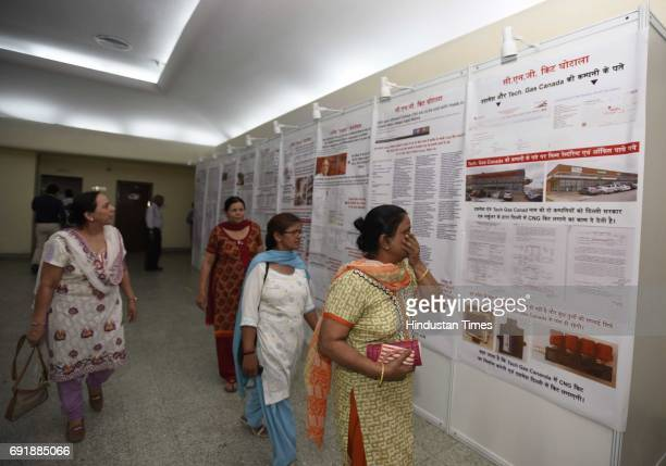 People look at an exhibition organised by former Minister Kapil Mishra during the launch of programme 'India Against Corruption2' against Arvind...