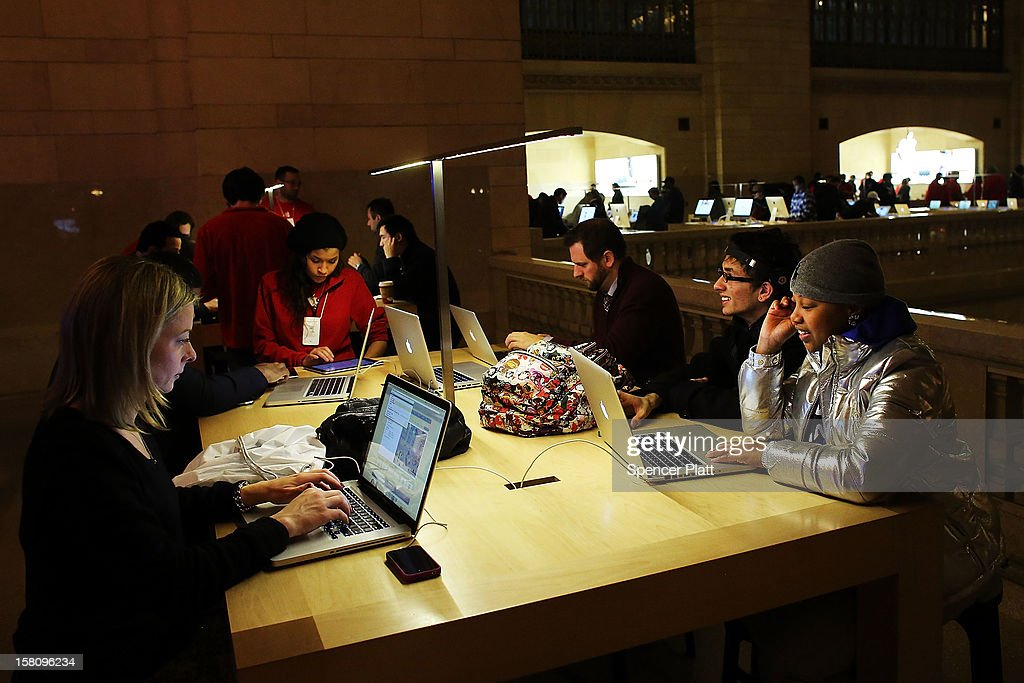 People look at Apple laptops at the Apple retail store in Grand Central Terminal on December 10, 2012 in New York City. Apple Inc. stock was down $4.56 per share, or 0.86 percent decline as investors and analysts worry that the U.S market is becoming saturated with apple products. Apple, the world's most valuable publicly traded company, has lost $167 billion in market value in less than three months.