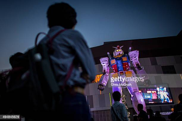 People look at at Gundam an 18meter tall giant robot on permanent display at Odaiba on May 31 2014 in Tokyo Japan Odaiba is a large artificial island...