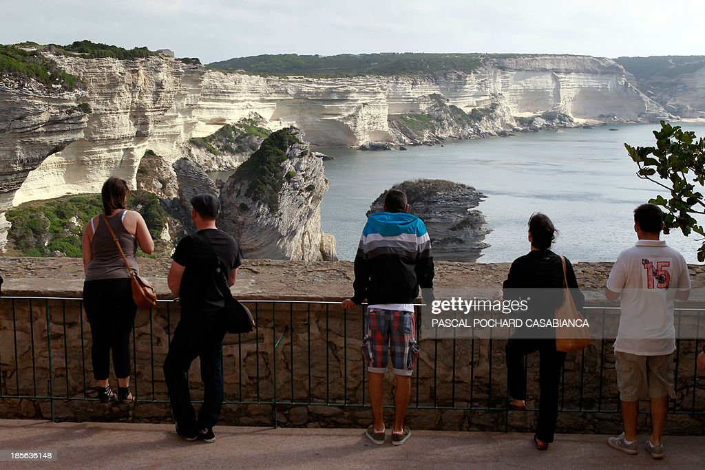 People look at Bonifacio cliffs, France's southern Mediterranean island of Corsica, on October 22, 2013. Bonifacio is classified as one of France's most beautiful villages.
