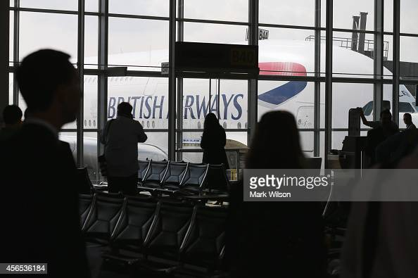 People look at British Airways' new super jumbo Airbus A380 after it arrived at Washington Dulles International Airport October 2 2014 in Dulles...