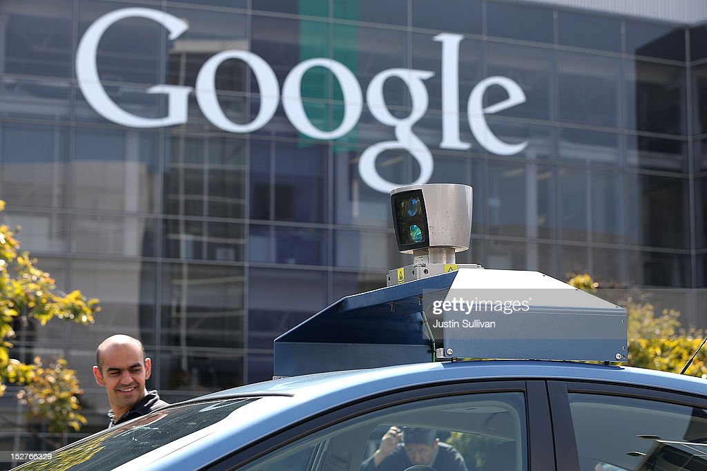 People look at camera on top of a Google self-driving car at the Google headquarters on September 25, 2012 in Mountain View, California. California Gov. Jerry Brown signed State Senate Bill 1298 that allows driverless cars to operate on public roads for testing purposes. The bill also calls for the Department of Motor Vehicles to adopt regulations that govern licensing, bonding, testing and operation of the driverless vehicles before January 2015.