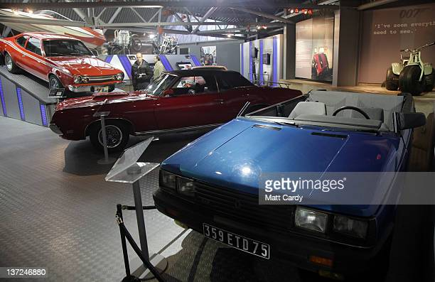 People look at cars including a roofless Renault 11 TXE that was used in the 1985 James Bond film A View To a Kill currently displayed at the Bond In...