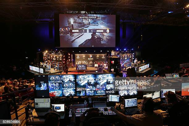 People look at competitors playing Call of Duty Back Ops 3 during the ESWC on May 7 2016 at the Zenith in Paris The video game event gather the world...